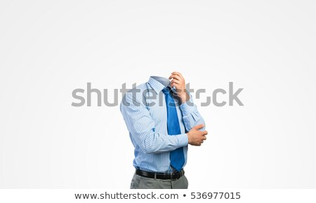 Pensive businessman with hand on chin Stock photo © stokkete