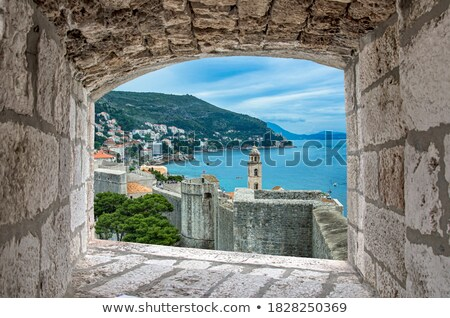 Dubrovnik defense walls and rooftops view Stock photo © xbrchx