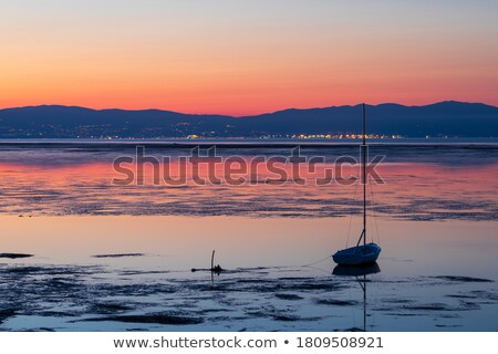 Small lagoon and sailboat on the horizon Stock photo © serg64