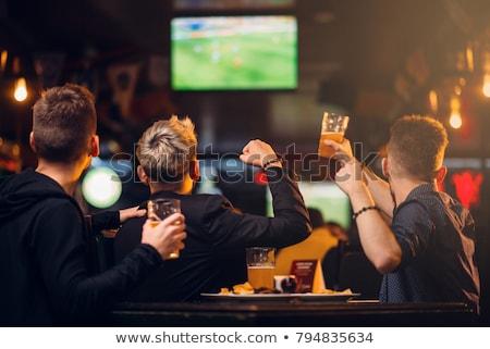 друзей питьевой пива смотрят Футбол телевизор Сток-фото © dolgachov