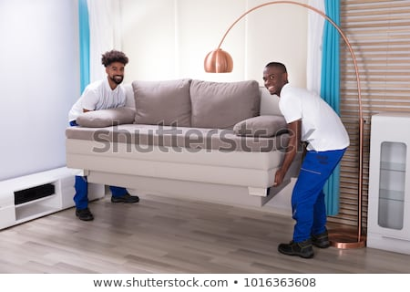 Two African Male Movers Moving Sofa Stock photo © AndreyPopov