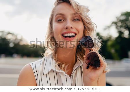 close up portrait of a smiling young girl in summer dress stock photo © deandrobot