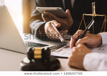 Stock photo: Business People And Lawyers Discussing Contract Papers Sitting A
