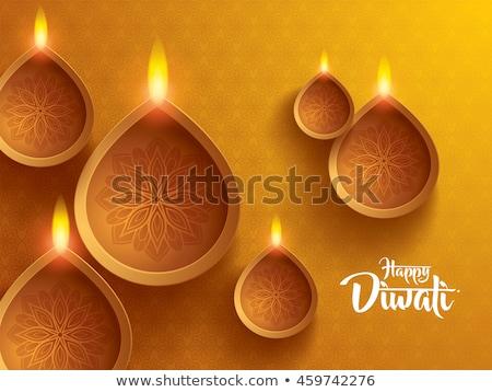 beautiful diwali diya lamps on decorative background Stock photo © SArts