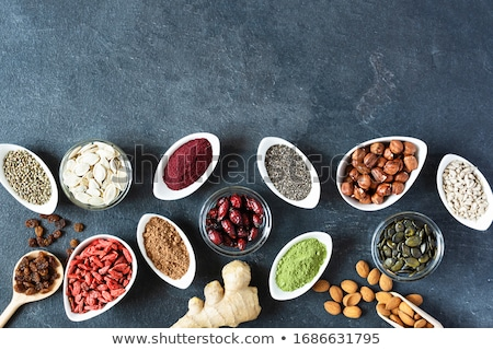Various superfoods in small bowl on black background Stock photo © Illia
