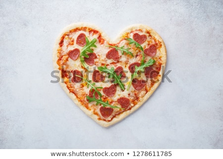 Heart shaped pizza with tomatoes and mozzarella Stock photo © karandaev