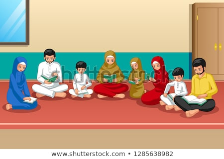Muslim Family Studying Quran and Praying at Home Stock photo © artisticco