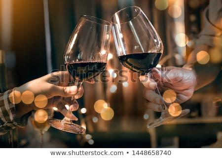 couple toasting wineglasses with friends stock photo © kzenon