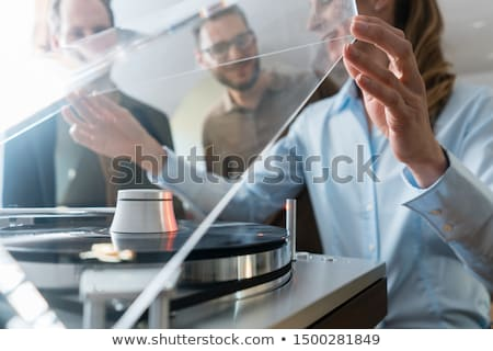 Woman listening to music from a Hi-Fi stereo Stock photo © Kzenon
