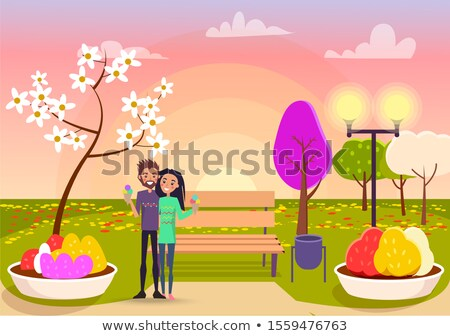 Cute Embracing Couple Holds Ice Cream on Sunset Stock photo © robuart