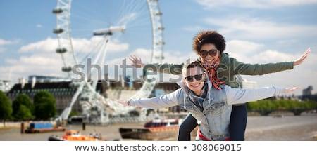 Stockfoto: Friends In Sunglasses Over Ferry Wheel In London