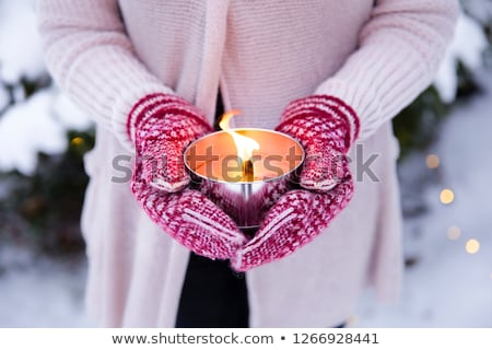 close up of hands in winter mittens holding candle Stock photo © dolgachov