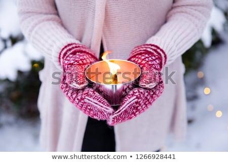 közelkép · kezek · tél · ujjatlan · kesztyűk · tart · gyertya - stock fotó © dolgachov