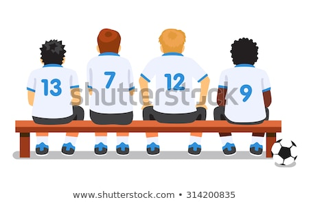 Junior Soccer Players Sitting on Football Soccer Team Bench stock photo © matimix