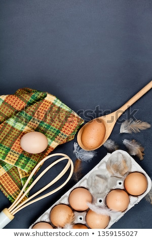 Eggs, kitchen utensil and feathes. Stock photo © marylooo