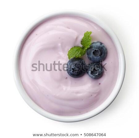 Arándanos yogurt tazón blanco cuchara de madera escritorio Foto stock © AndreyPopov