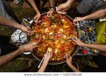 man with a typical spanish paella Stock photo © nito