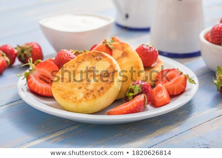 Portion of ricotta fritters with fresh strawberries Stock photo © Alex9500