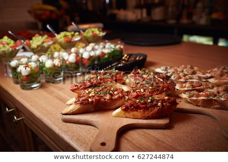 Appetizer bruschetta with tuna and tomatoes. Italian cuisine.  Stock photo © Illia