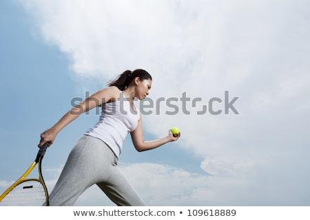 beautiful woman getting ready to play tennis stock photo © kzenon