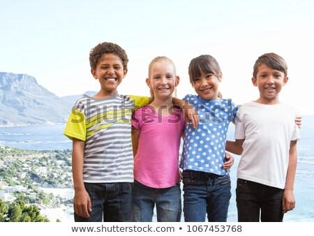 Groep kinderen glimlachend kustlijn digitale composiet Stockfoto © wavebreak_media