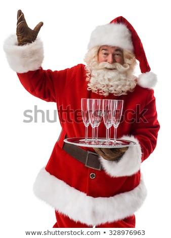 santa claus holding champagne glasses on the tray stock photo © dashapetrenko