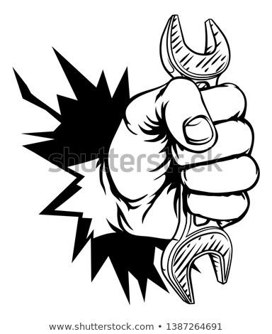 Plumber Mechanic Hand Fist Holding Spanner Wrench Stock photo © Krisdog