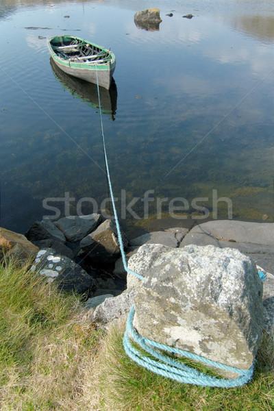 Roeiboot klein meer water hout reizen Stockfoto © t3mujin