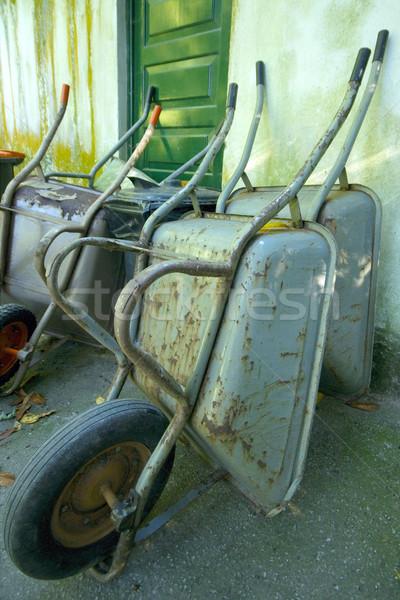 Yeşil paslı Metal araçları Retro tekerlek Stok fotoğraf © t3mujin