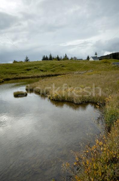 Lake with Icelandic church Stock photo © t3mujin