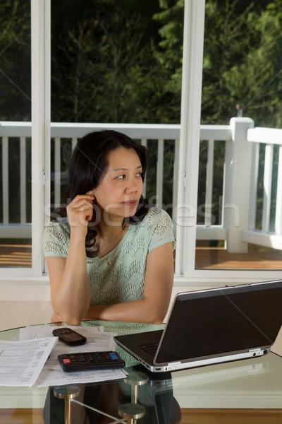 Olgun kadın düşünme çalışma ev dikey fotoğraf Stok fotoğraf © tab62