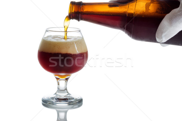 Pouring fresh cold beer into glass goblet  Stock photo © tab62
