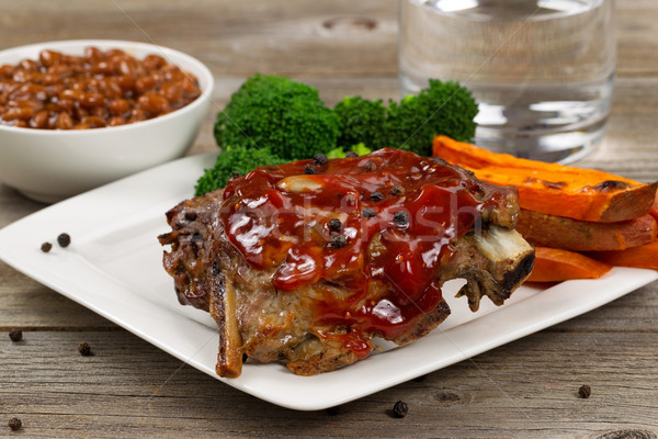 Juicy BBQ ribs and side dishes with water Stock photo © tab62