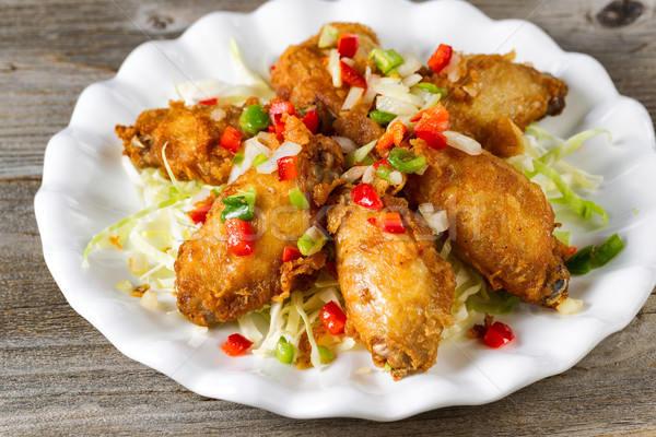 Chicken wings in white plate ready to eat  Stock photo © tab62