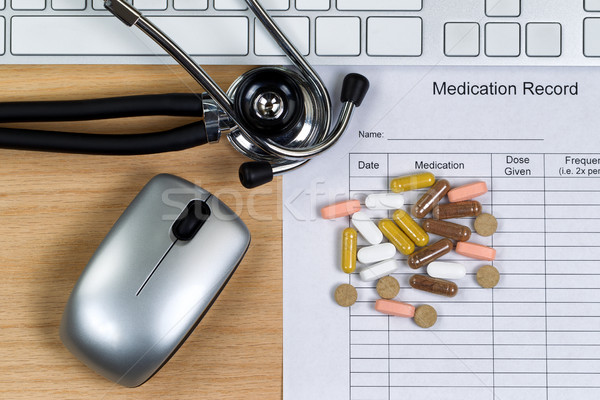 Wooden desktop with patient medication form plus pills and equip Stock photo © tab62