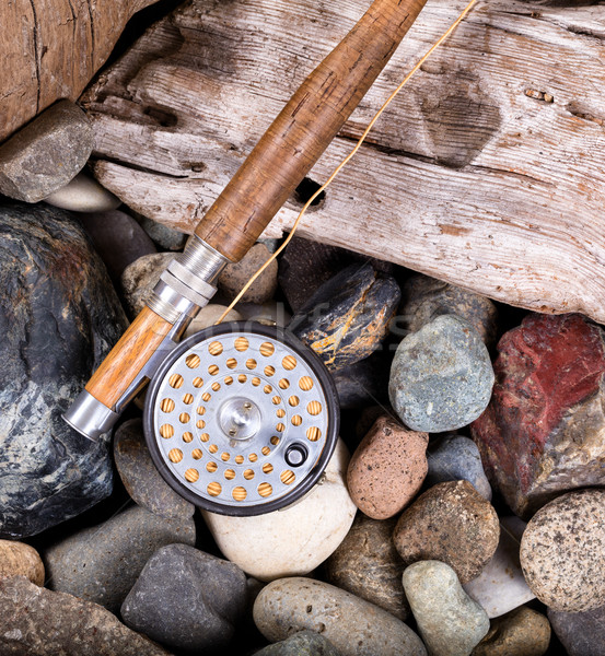 Vintage fly fishing outfit on rocks and wood background  Stock photo © tab62