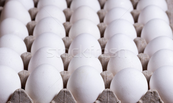 Cardboard carton filled with fresh whole eggs  Stock photo © tab62