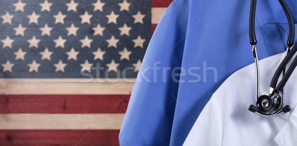 Close up of medical scrubs and stethoscope with rustic USA flag  Stock photo © tab62