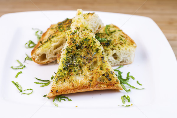 Freshly Baked Garlic Bread with herbs and butter  Stock photo © tab62