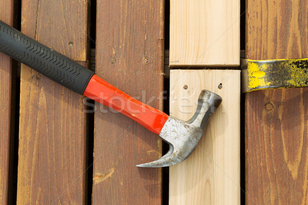 Aligning New Wood into Cedar Deck  Stock photo © tab62
