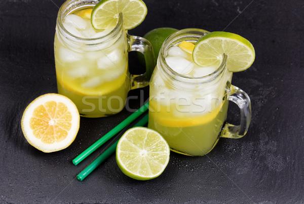 Homemade lemonade in jar glasses on black natural slate stone ba Stock photo © tab62