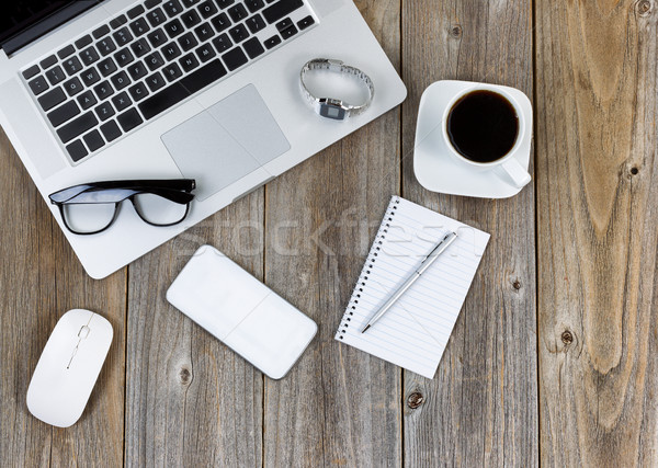 Modern technology with traditional office objects on wooden desk Stock photo © tab62
