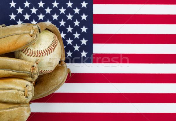 Worn baseball glove and ball on American Flag  Stock photo © tab62