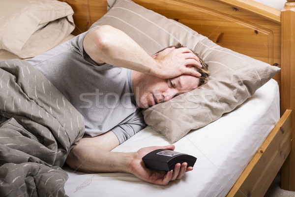 Mature man waking up for daily job  Stock photo © tab62