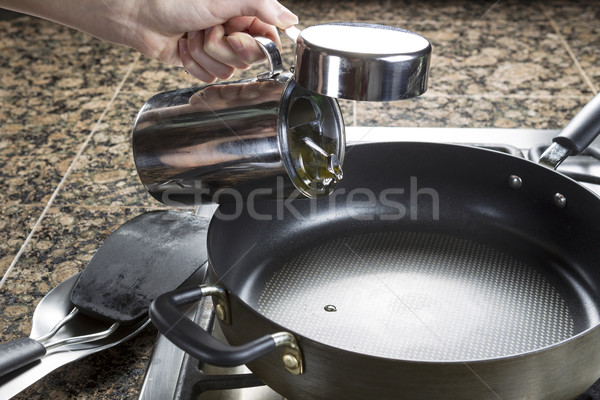 Adding cooking oil in frying pan Stock photo © tab62