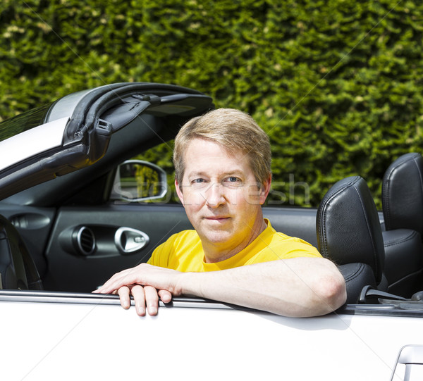 Mature man with arms on top of convertible car door  Stock photo © tab62