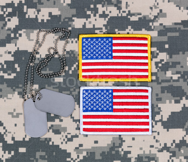 Small USA flag patches and ID tags on military battle dress unif Stock photo © tab62