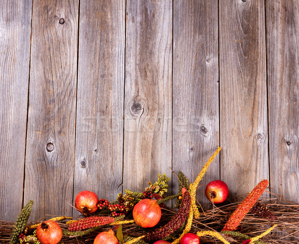 Bottom border of autumn holiday decorations on rustic wooden boa Stock photo © tab62