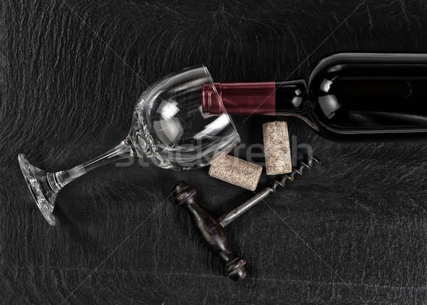 Overhead view of vintage corkscrew with red wine bottle and glas Stock photo © tab62