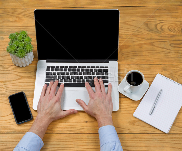 Male hands typing on laptop keyboard Stock photo © tab62